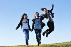 women-jumping-for-joy