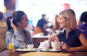 women-talking-having-coffee
