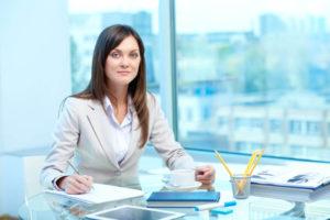 woman-at-desk-writing
