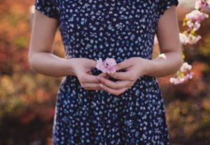 woman-holding-a-flower