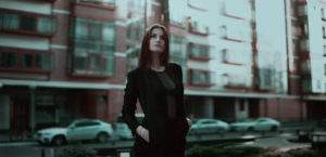 woman-thinking-in-city-setting