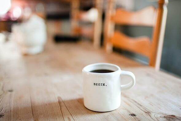 A coffee cup that says begin your dau
